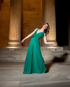 Our model in the Calypso Polymorphic Maxi Dress, in the Emerald Green shade from the front once again