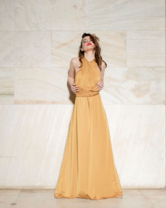 Our model in the Calypso Polymorphic Maxi Dress, in the Yellow Mustard shade from the front once again