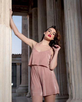 Our model in the Celine Pleated Playsuit in a Pink shade from the front