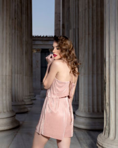 Our model in the Celine Pleated Playsuit in a Pink shade from the side