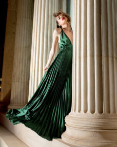 Our model in the Frances Stevens Grecian Pleated Dress, in the Emerald Green shade from the front